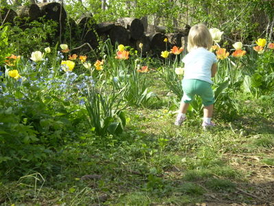 Faiths daughter abigail smells flower