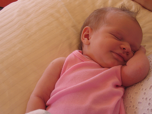 Sweet smiling newborn girl