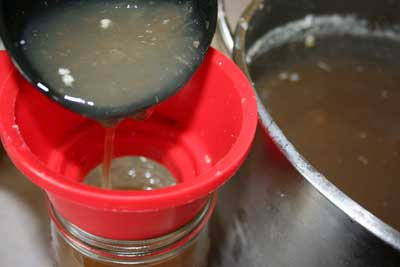 Pouring-thick-broth-into-jar