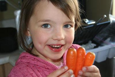Abbie-holding-garden-carrots